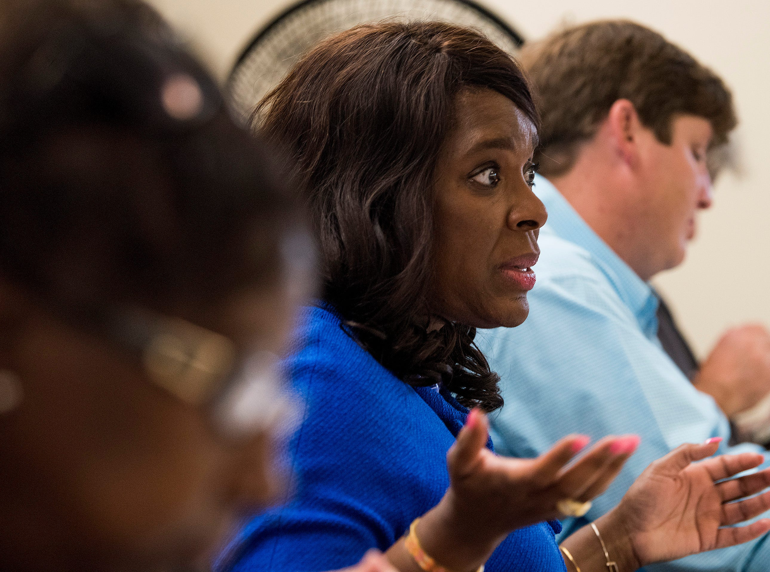 Congresswomen Terri Sewell leads a discussion on solutions after taking a group of engineering and health experts to homes with sewage problems in rural Lowndes County, Ala., on Monday, July 30, 2018.
