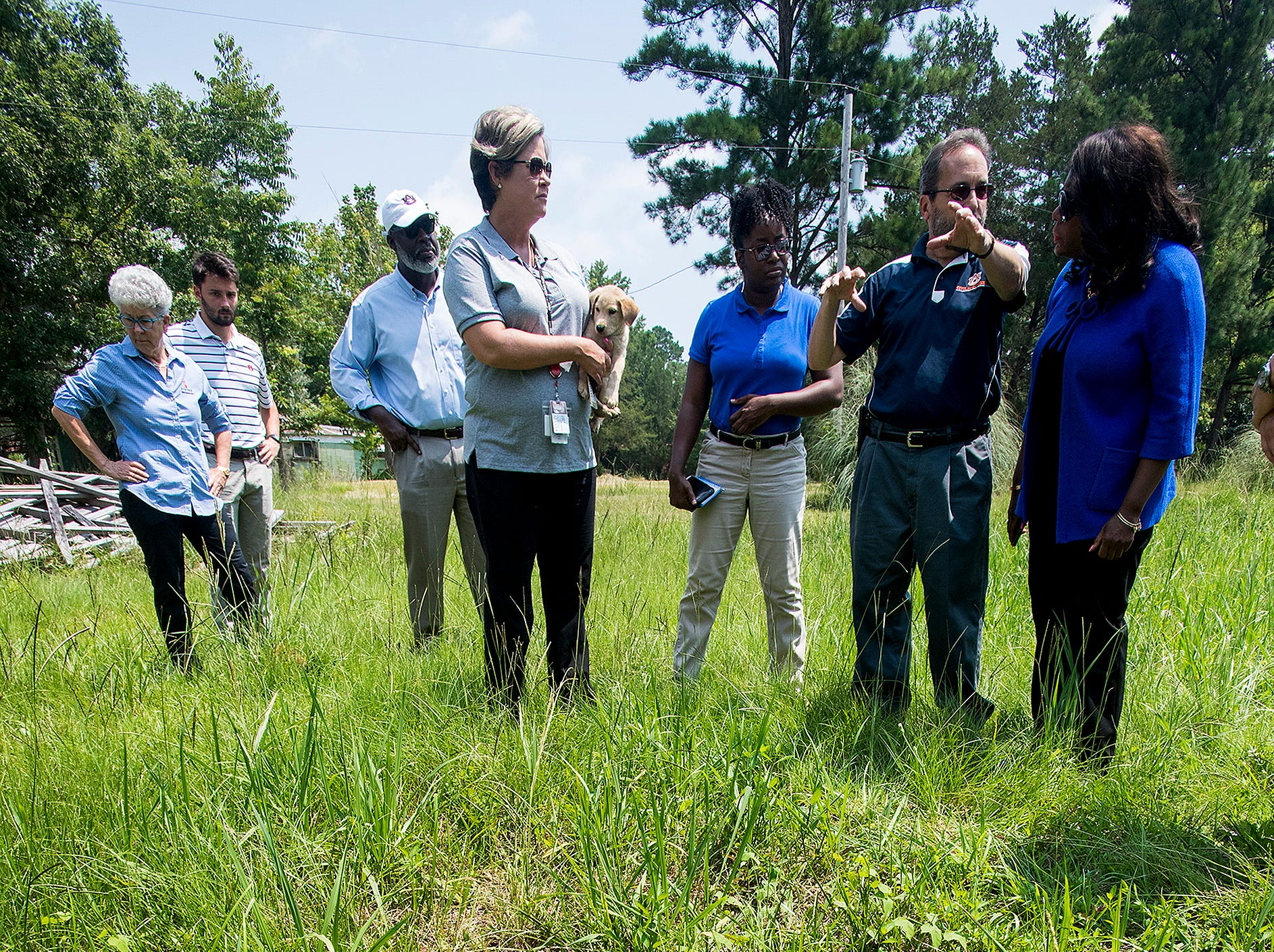 Congresswomen Terri Sewell talks with a group of engineering and health experts as they tour homes with sewage problems in rural Lowndes County, Ala., on Monday, July 30, 2018.