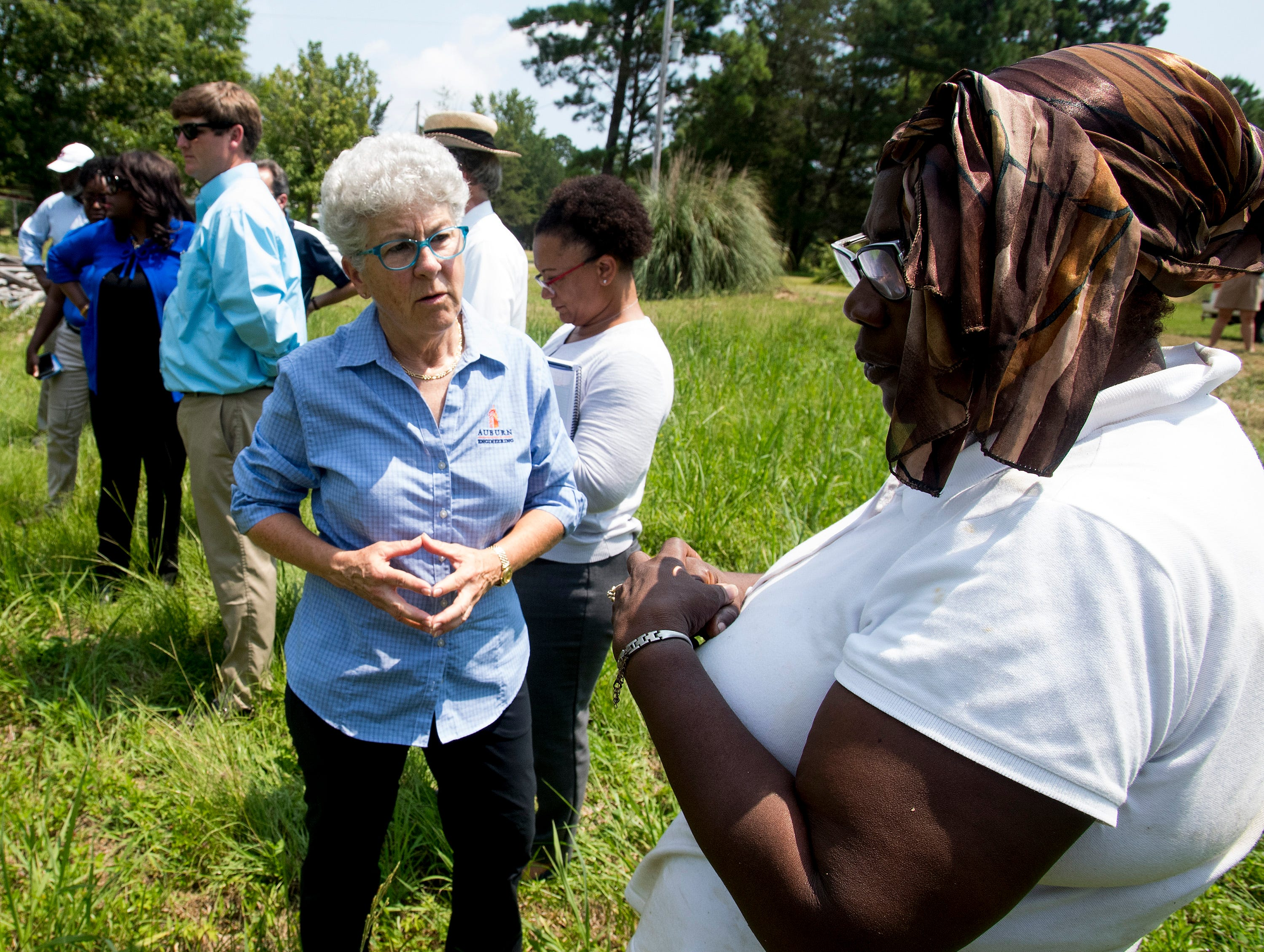 Melissa Herkt, Alumni Advisor of Engineers Without Borders, left, speaks with homeowner Bonnie Bryant as Congresswomen Terri Sewell takes a group of engineering and health experts to homes with sewage problems in rural Lowndes County, Ala., on Monday, July 30, 2018.