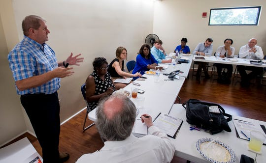 Kevin White, from the University of South Alabama, speaks after Congresswomen Terri Sewell took a group of engineering and health experts to homes with sewage problems in Lowndes County, Ala., on Monday, July 30, 2018.