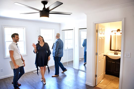 Real estate agent Lee Pfund shows the master bedroom of a house in West Nashville to Will Reedy and Rachel Villanueva on Friday, July 27, 2018. The home is being flipped by a cryptocurrency firm.