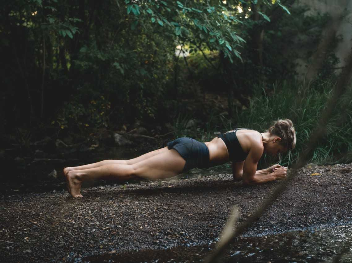 Katie Roberts poses for a portrait doing a plank.