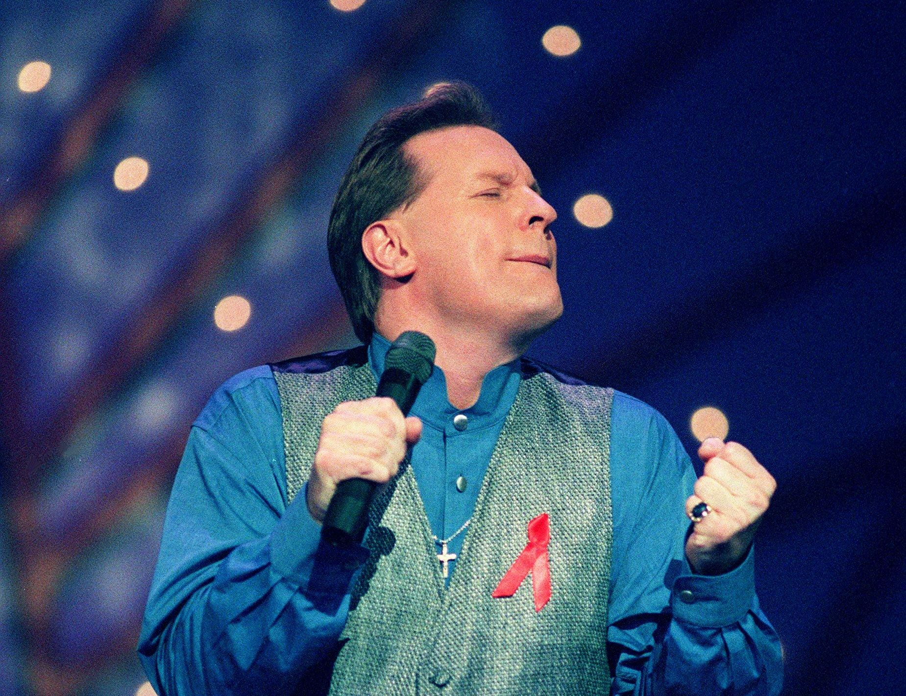 Collin Raye performs during the 30th annual CMA Awards show at the Opry House on Oct. 2, 1996.