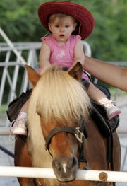 Enjoy a pony ride at the Riverdale Labor Day Street Fair on Monday, September 3.