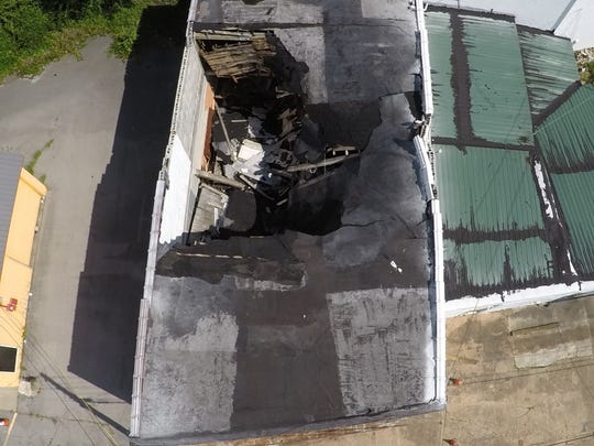 An aerial view of the former Randy's Record Shop building shows the damage of the roof collapse.