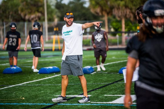 New head coach Tom Scalise runs drills during the first day of football practice at Gulf Coast High School in North Naples on Monday, July 30, 2018.
