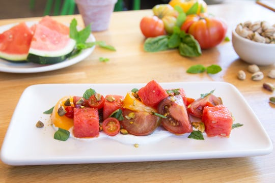 True Food Kitchen's new seasonally-inspired summer menu incluldes a salad of vine-ripened heirloom tomatoes and watermelon.
