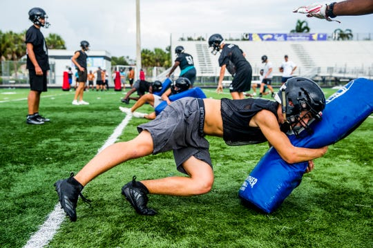 The Gulf Coast High School football team runs drills during the first day of practice under new head coach Tom Scalise at Gulf Coast in North Naples on Monday, July 30, 2018.