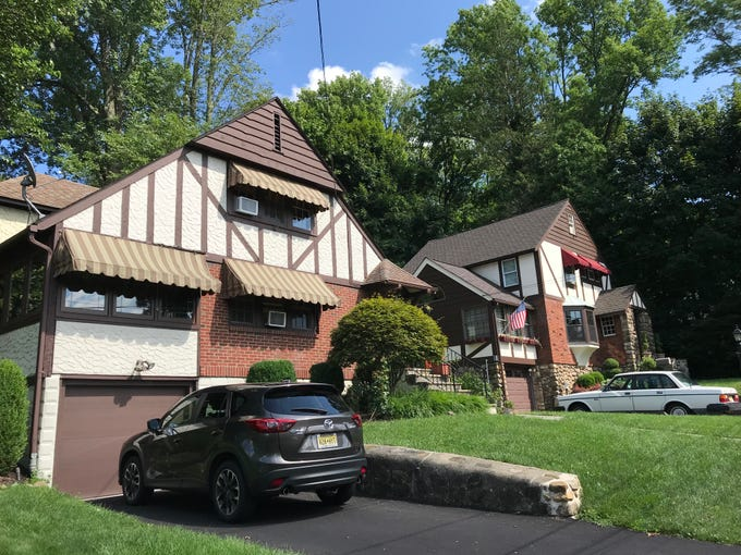 Two of the typical Tudor homes of Lake Mohawk in Sparta, N.J. appear freshly landscaped on July 26, 2-18.