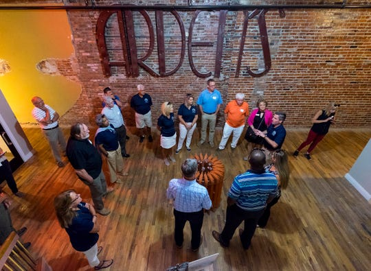 Port Huron City Manager James Freed talks to members of the Holland and Port Huron city councils in the lobby of the Ballentine lofts Monday, July 30, 2018, during the mayor's exchange in Port Huron. As part of the mayor's exchange, Port Huron's mayor, along with members of the city council and administration, visited Holland in June.