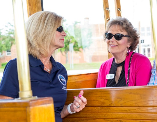 Port Huron Mayor Pauline Repp, left, talks to Holland Mayor Nancy DeBoer while riding the Blue Water Trolley through Port Huron Monday, July 30, 2018 during the mayor's exchange.
