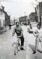 Bobby Powell, left, and Curtis Calhoun on Codorus Street prior to the eminent domain in 1958 that demolished the neighborhood.