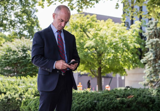 FBI Indianapolis Special Agent in Charge Grant Mendenhall checks his phone at Richmond's Elstro Plaza on July 27, 2018.