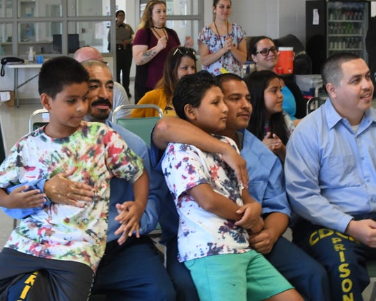 Kids sit on their dads' laps during Camp Grace Friday at Salinas Valley State Prison.
