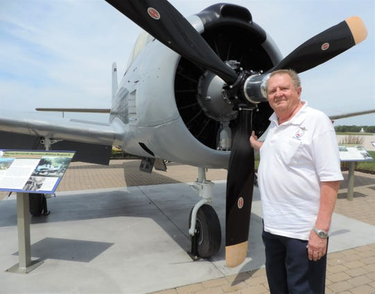Neil Hansen next to an AT-28D, one of the planes used during the Vietnam War. The plane is located at the Aviation Heritage Center of Wisconsin in Sheboygan. Hansen flew similar planes during his time in the air force.