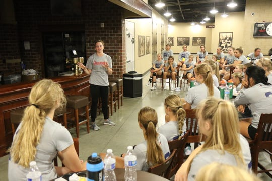 Former Roosevelt and Louisville standout Maggie DeJong takes questions from the players attending the Summer Slam 2018 at the Pentagon on Sunday.