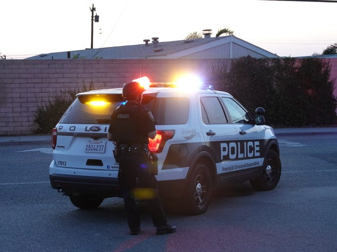 A police officer stands near the scene of an officer-involved shooting in Oxnard.