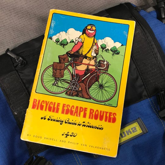 """Bicycle Escape Routes: A Touring Guide to Wisconsin"" including essays about riding in various regions of the state. It came with maps that highlighted low-traffic roads."