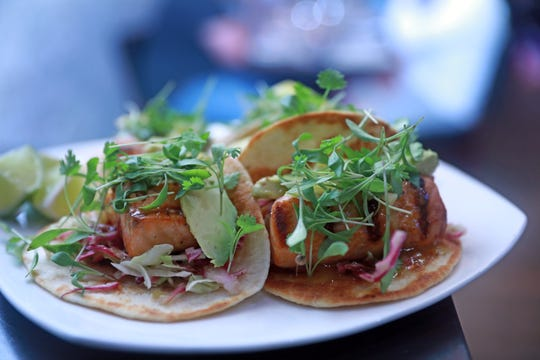 """Salmon tacos with marinated cabbage, avocado and mango habanero salsa is served during """"Dinner with Jeanne"""" at DonJito in Mamaroneck July 26, 2018."""