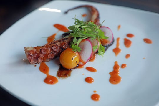 "Pulpo A La Plancha, crisp octopus, burst tomato, balsamic onion jam and red chili salsa is served during  ""Dinner with Jeanne"" at DonJito in Mamaroneck July 26, 2018."