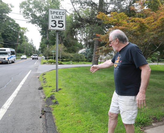 Michael Sandler of Montebello talks about being awake all night with The New York state Department of Transportation paving of Route 202 until 2:30 am in front of his home on July 30, 2018.