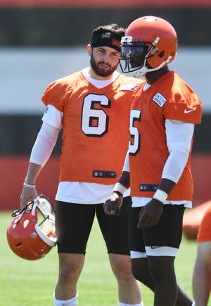 Cleveland Browns quarterback Baker Mayfield (6) watches as quarterback Tyrod Taylor (5) calls a play during organized team activities at the Cleveland Browns training facility.