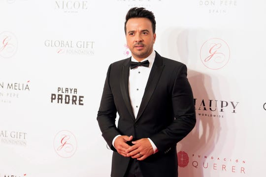 Luis Fonsi poses as he arrives to 'The Global Gift Gala' to raise funds for charity foundations in Marbella, Malaga, in southern Spain on July 29, 2018.