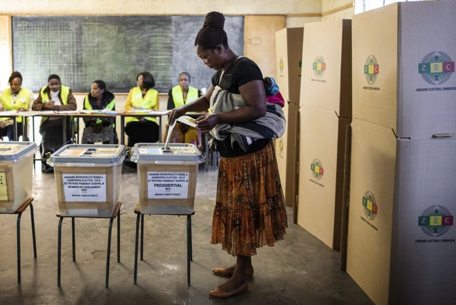 A member of the public casts her vote in the Zimbabwean General Election on July 30, 2018 in Harare, Zimbabwe.