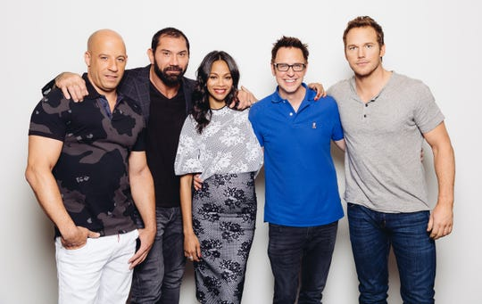 """The cast of the """"Guardians of the Galaxy"""" franchise is speaking out on behalf of fired director James Gunn (second right). From left:  Vin Diesel, Dave Bautista, Zoe Saldana, Gunn and Chris Pratt."""