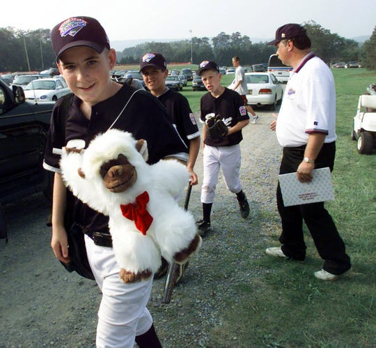 """(PSPORTS) ASBURY PARK PRESS PHOTO BY THOMAS P. COSTELLO - - - 8/24/98 - - -  Toms River East American Little Leaguer Gabe Gardner walks with the team's mascot - """"The Beast From The East"""" - after a practice Sunday before the game against the Central team from Georgetown LL in Jenison, MI, at Lamade Stadium in South Williamsport, PA, during the Little League World Series."""