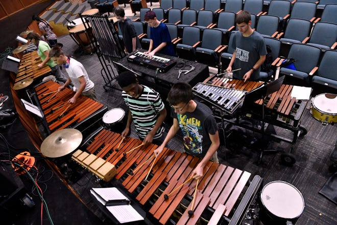 Percussionists in the Cooper High School Band rehearse Tuesday.