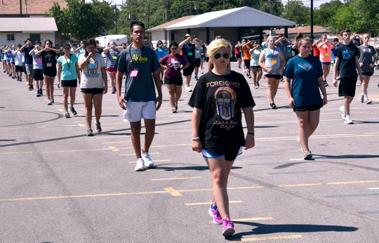 Freshmen members of the Abilene High School Eagle Band practice marching July 31.