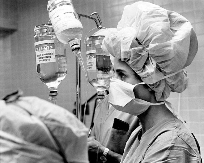 A nurses assists during a procedure at West Texas Medical Center April 8, 1971. The hospital which would later be known as Abilene Regional Medical Center was located at that time where Texas State Technical College is now on E. Highway 80.