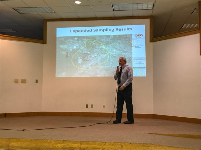 Gregg Brettman, a representative from the Michigan Department of Environmental Quality's remediation and redevelopment division, explains the testing results of the MDEQ's drinking well sampling at the town hall meeting at the Burma Center on Upton Avenue on Monday, July 30.