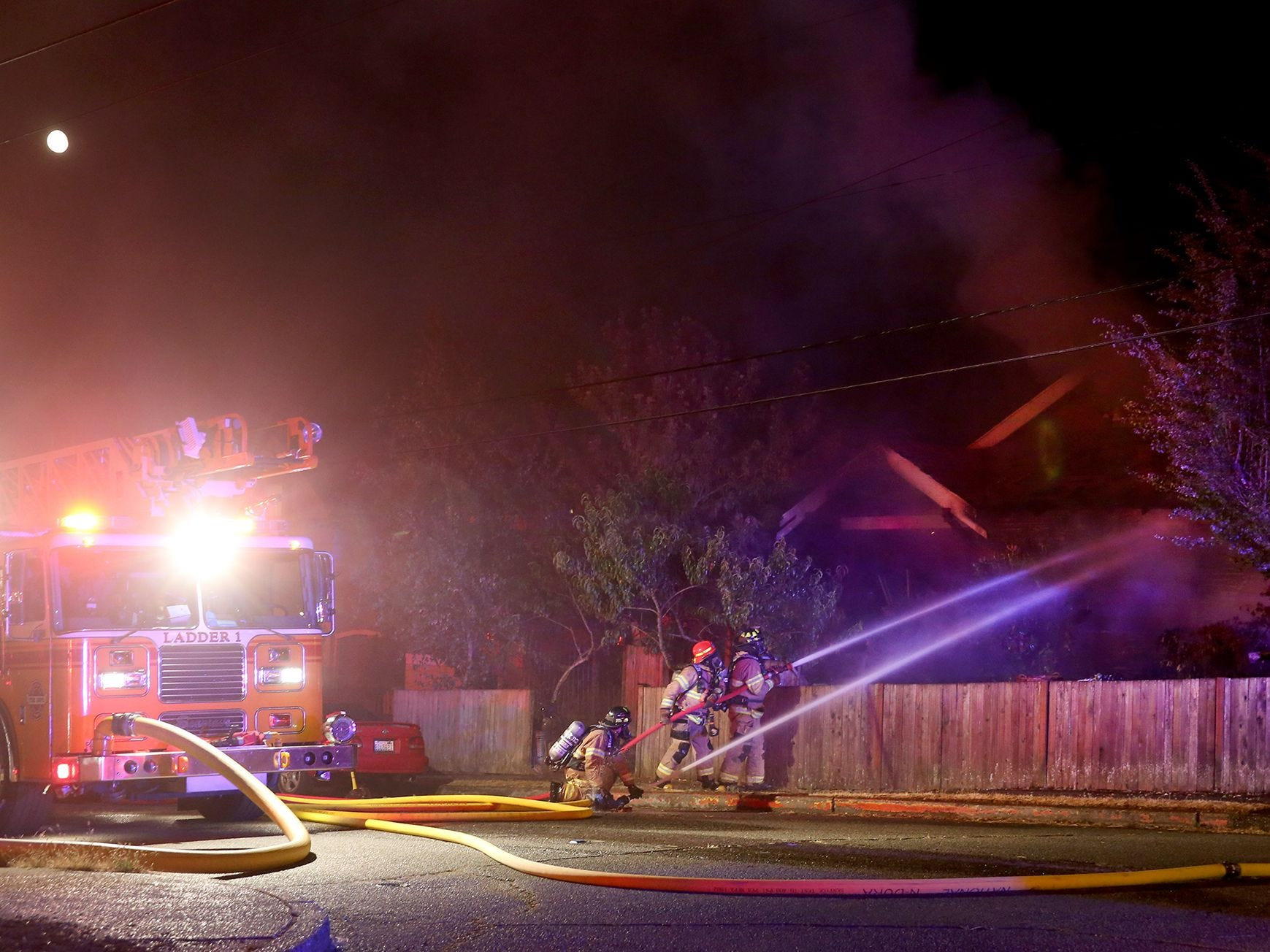 Bremerton firefighters battle a late night residential structure fire at 5th and Chester in Bremerton on Monday, July 30, 2018.