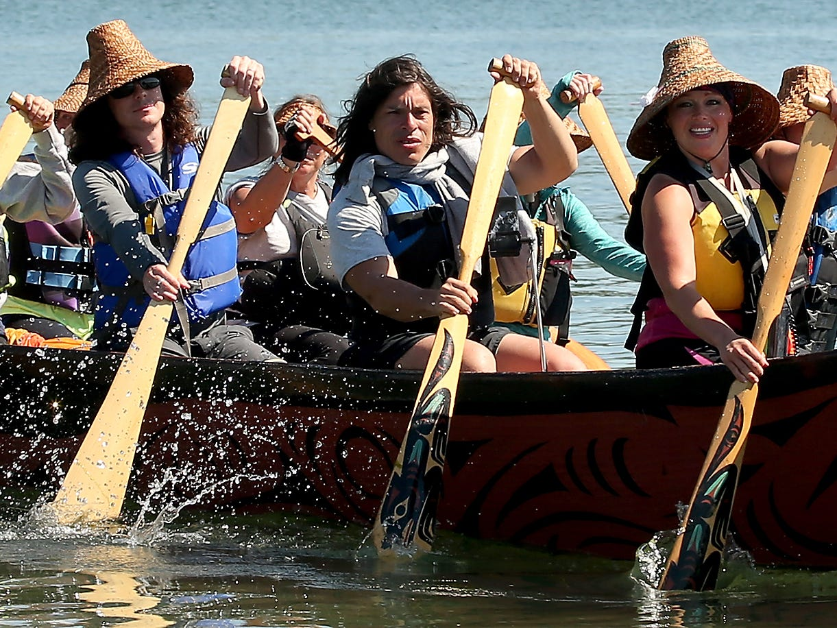 Pullers on the Jamestown S'Klallam canoe head for the beach at Point Julia on Tuesday, July 24, 2018.
