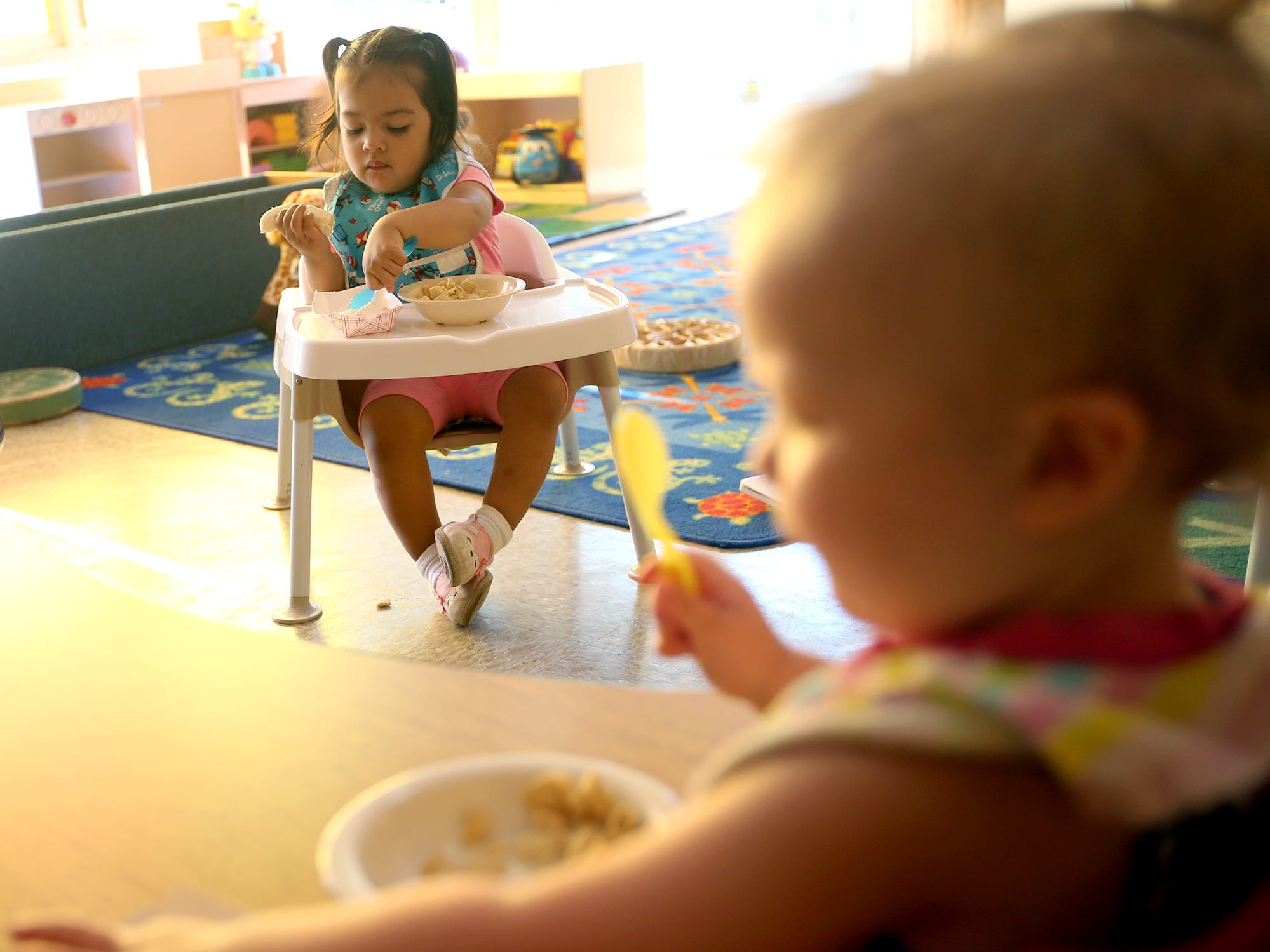Khaleesi Fontes, 1, eats a bit of banana and yogurt for breakfast at the Marion Forsman-Boushie Early Learning Center in Poulsbo on Thursday, July 26, 2018.