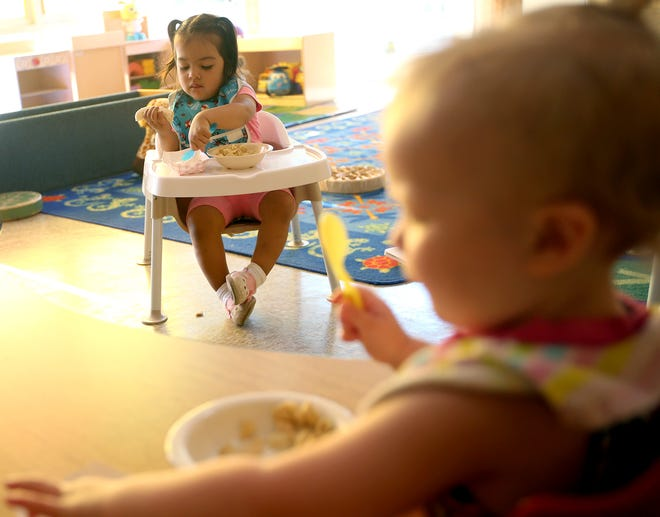 Khaleesi Fontes, 1, eats a bit of banana and yogurt for breakfast at the Marion Forsman-Boushie Early Learning Center in Poulsbo.