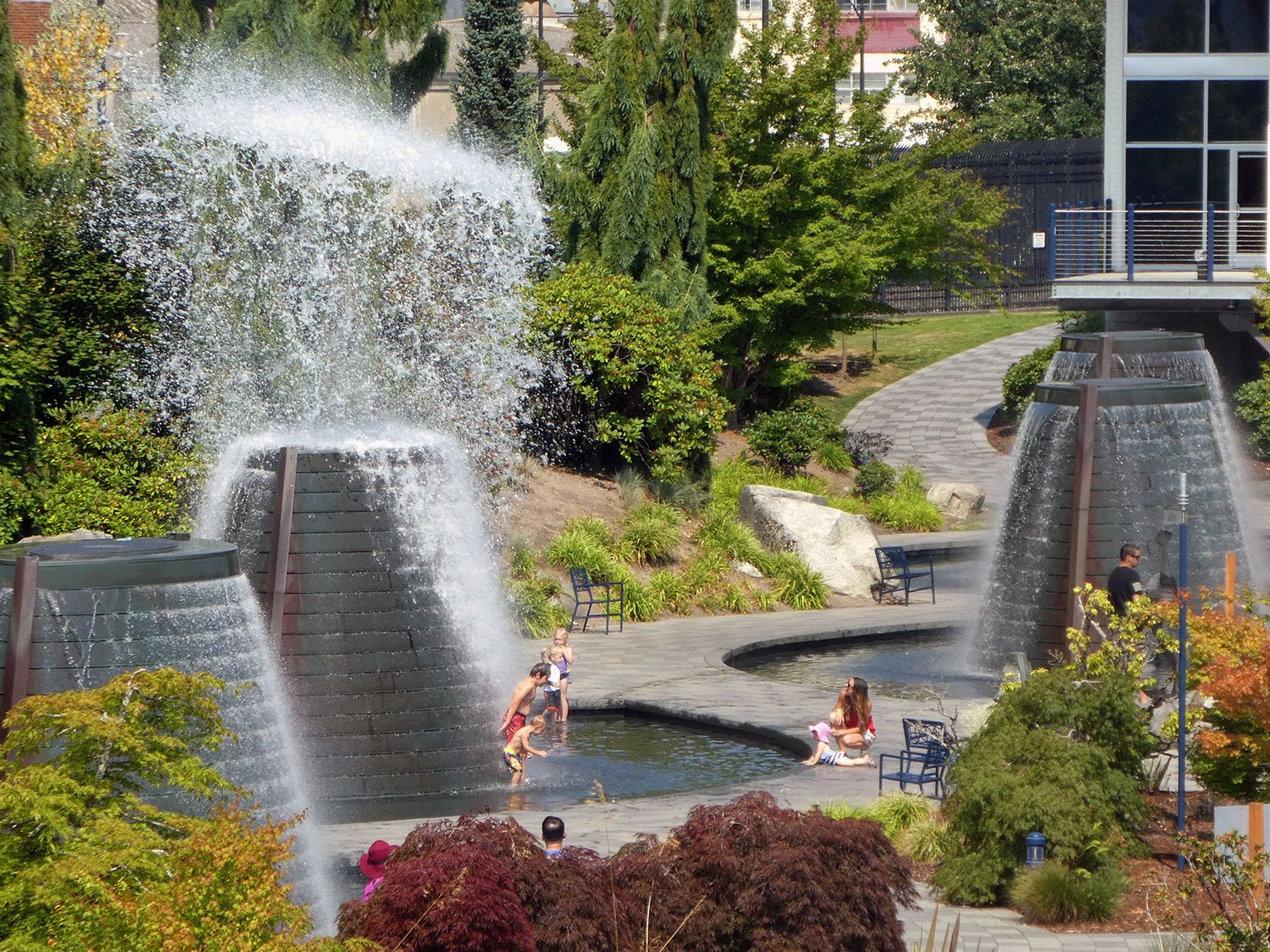 One of the Bremerton Harborside Fountains in Bremerton erupts on a hot Sunday.