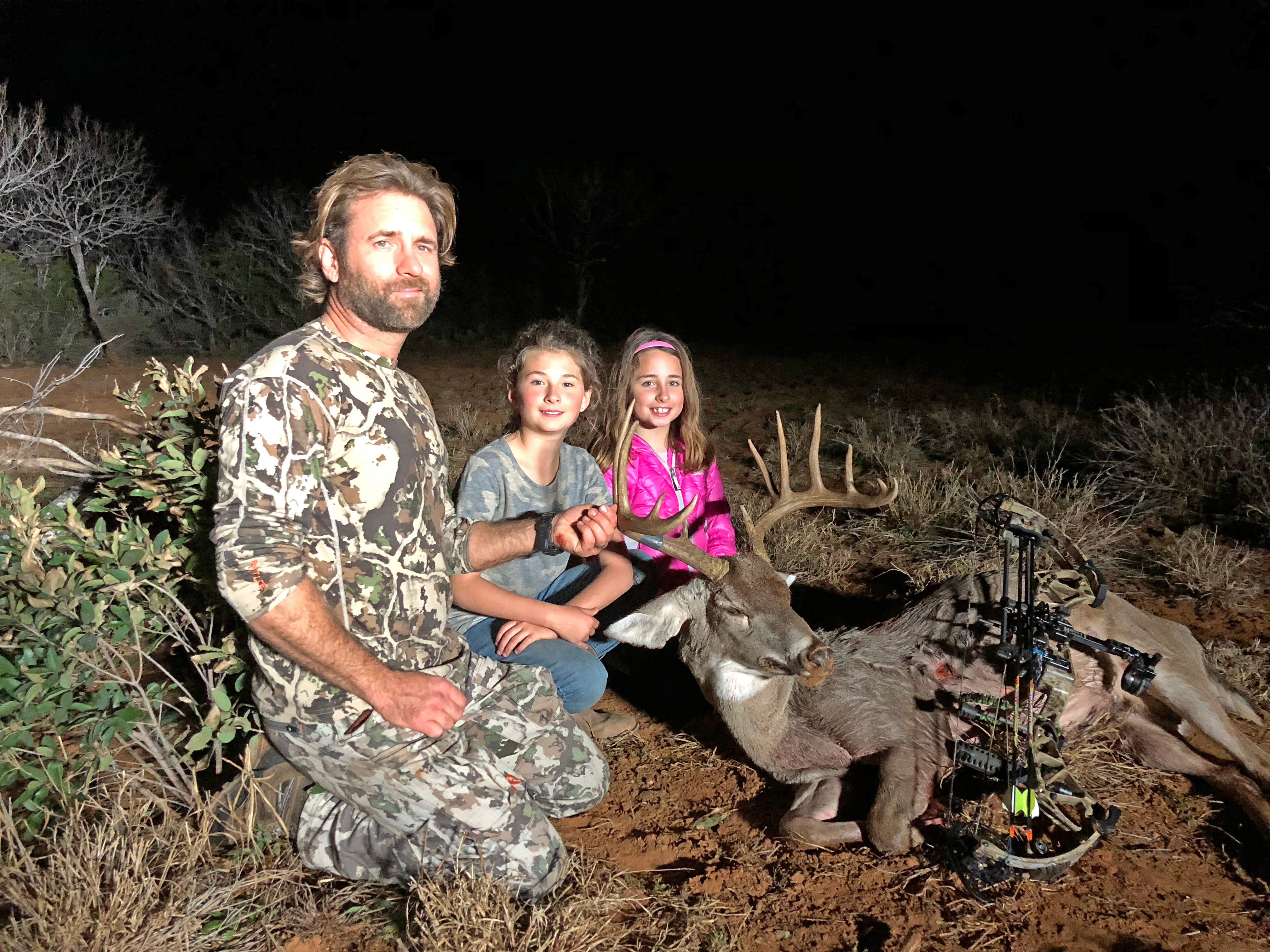 Bowhunter Chisum Cooke shot this 12-point buck while hunting near Encinal. That's daughters Rylee, 9, and Charlotte, 7, by his side.