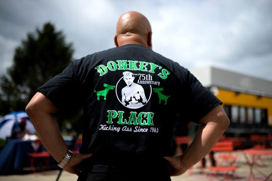 Camden mayor Frank Moran sports a Donkey's Place shirt as Donkey's Place celebrates its 75th anniversary with a celebration at city hall Tuesday, July 31, 2018 in Camden, N.J.