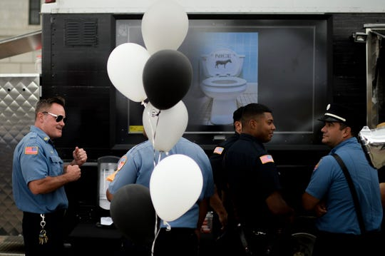 Camden County Police Department officers wait for cheesesteaks outside City Hall as Donkey's Place celebrates 75 years in the city.