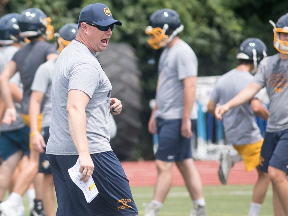 Moeller head coach Doug Rosfeld calls out instructions during the first day of football practice in Ohio, Monday July 30, 2018.