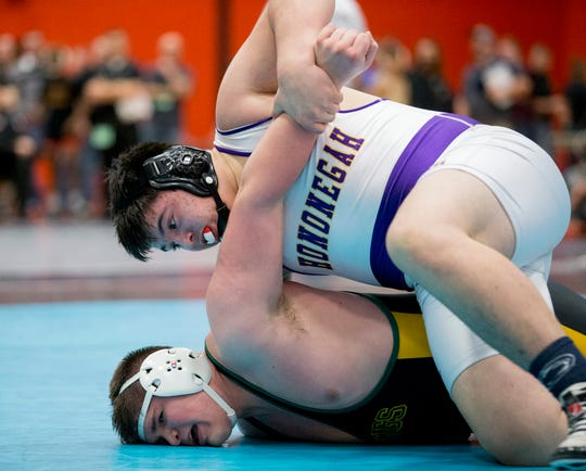 Hononegah's Tony Cassioppi works to flip Fremd's Zack Nemec on Wednesday, Dec. 23, 2015, during the championship heavyweight bout at the Dvorak wrestling tournament at Harlem High School in Machesney Park.