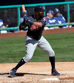 In this March 5, 2018, file photo, Cleveland Indians' Willi Castro hits against the Los Angeles Dodgers during the second inning of a spring training baseball game in Phoenix. Badly needing outfield help, the Cleveland Indians have acquired center fielder Leonys Martin from the Detroit Tigers.Cleveland also received right-hander Kyle Dowdy in the deal Tuesday, July 31, 2018, in exchange for shortstop prospect Willi Castro.