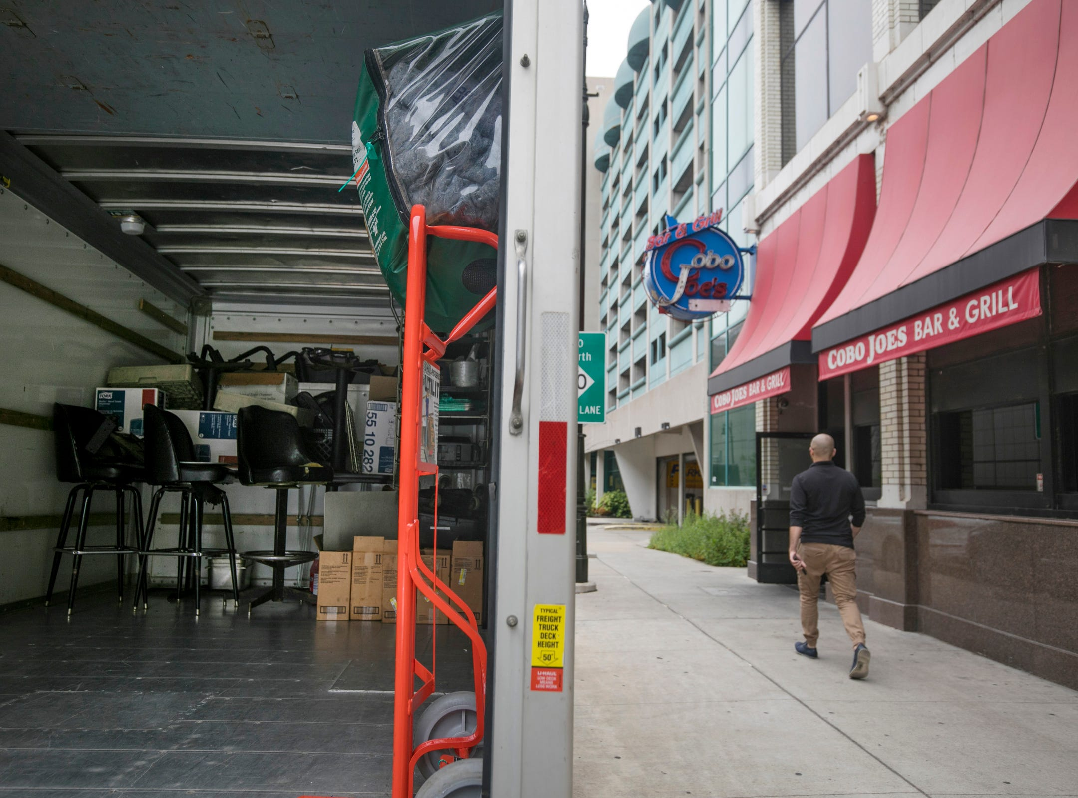 A U-Haul truck sits at the curb outside of Cobo Joe's as co-owners Richard Cadreau, 71, and Delroy Thomas, 49, pack up memorabilia before closing the doors on Tuesday, July 31, 2018.