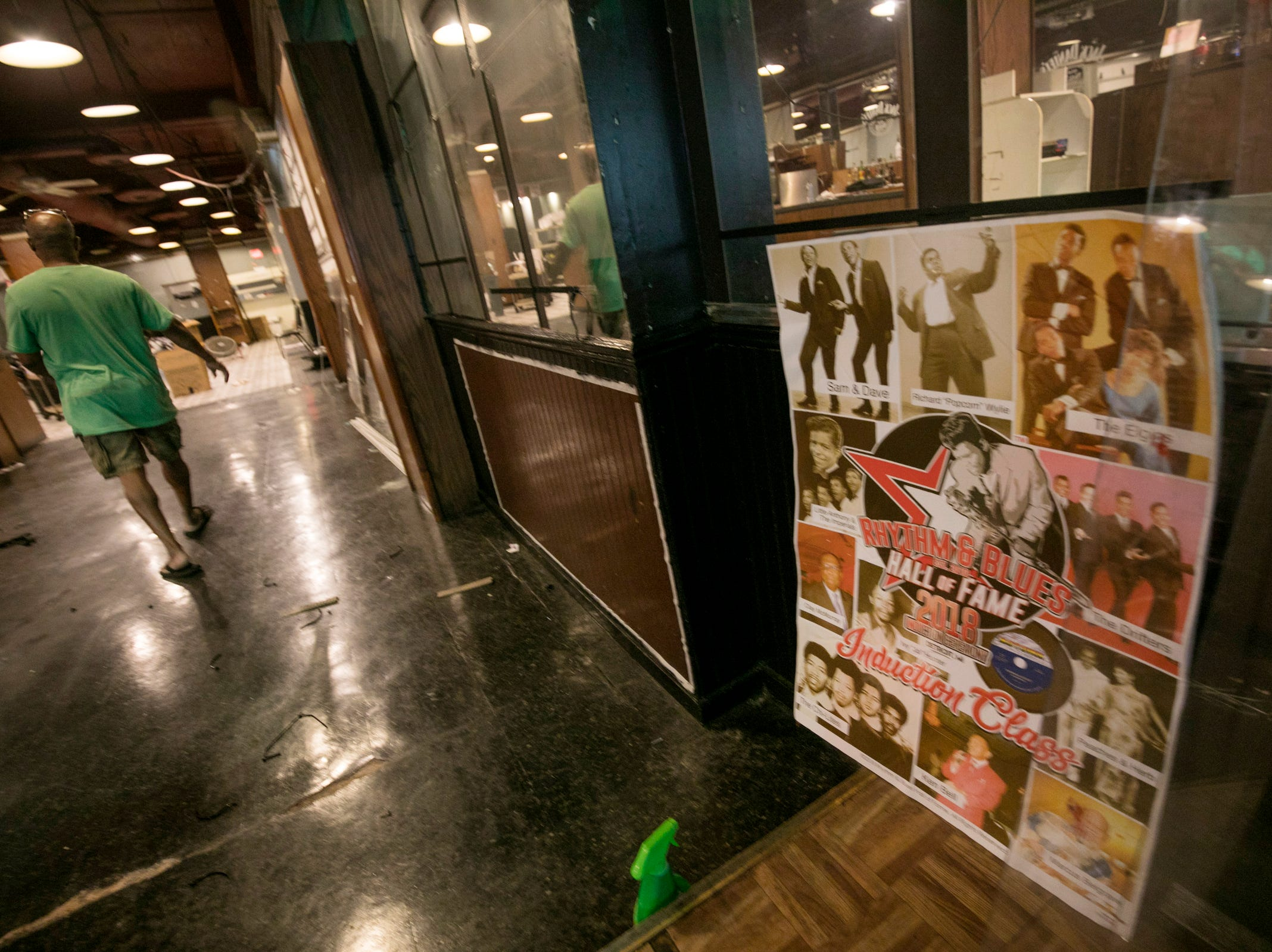 Cobo Joe's co-owner Delroy Thomas, 49, packs up memorabilia before closing the doors on Tuesday, July 31, 2018.