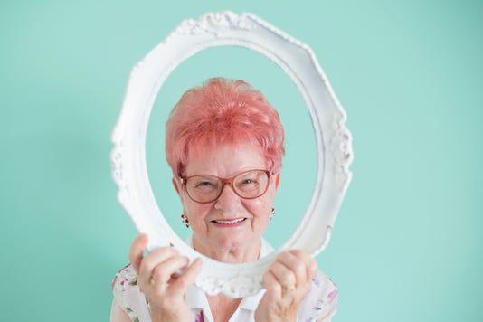 Headshot Of Senior Woman With Frame