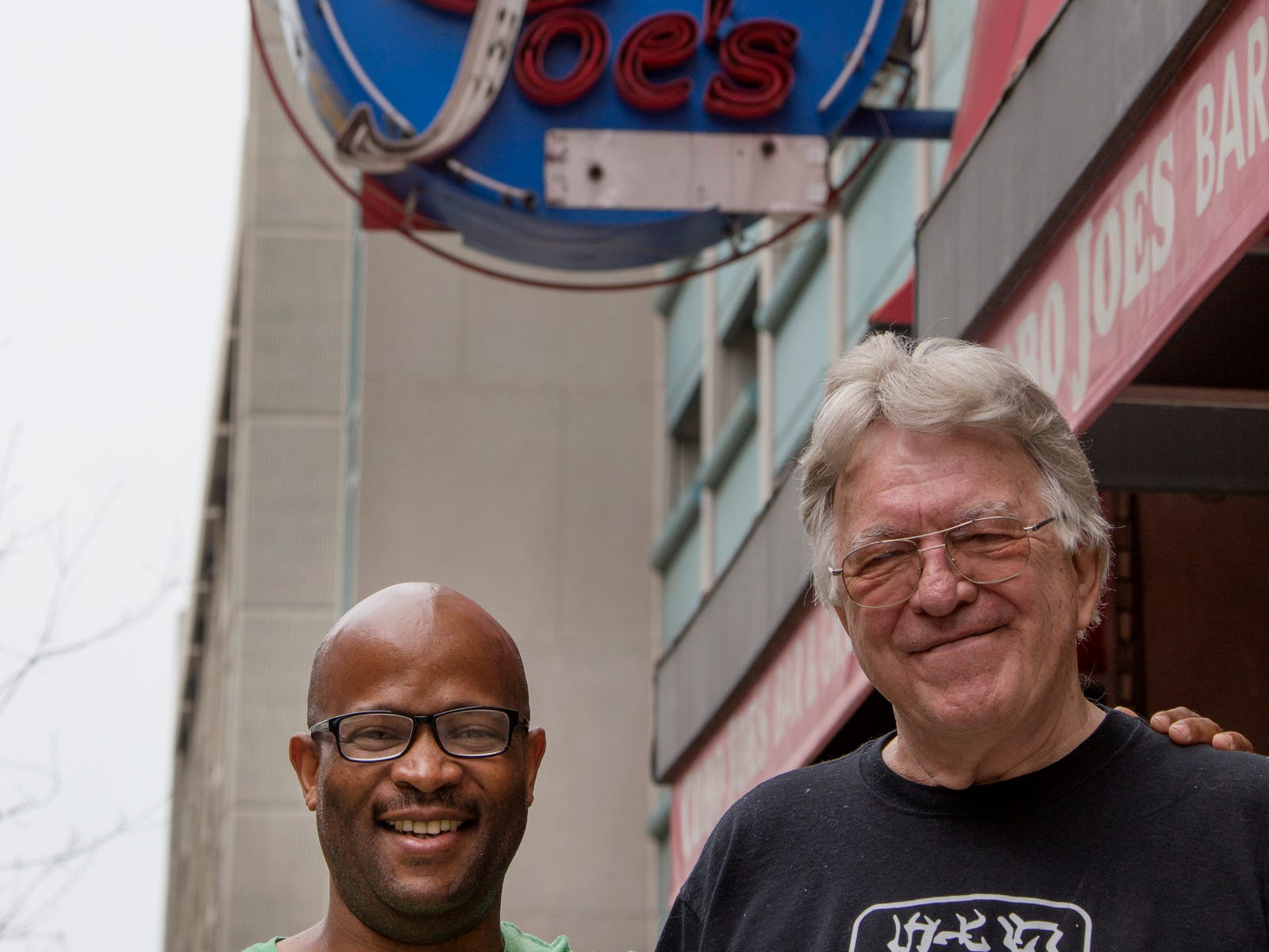 Cobo Joe's co-owners Delroy Thomas, 49, left, and Richard Cadreau, 71, pose for a portrait outside of the sports bar before closing the doors on Tuesday, July 31, 2018.