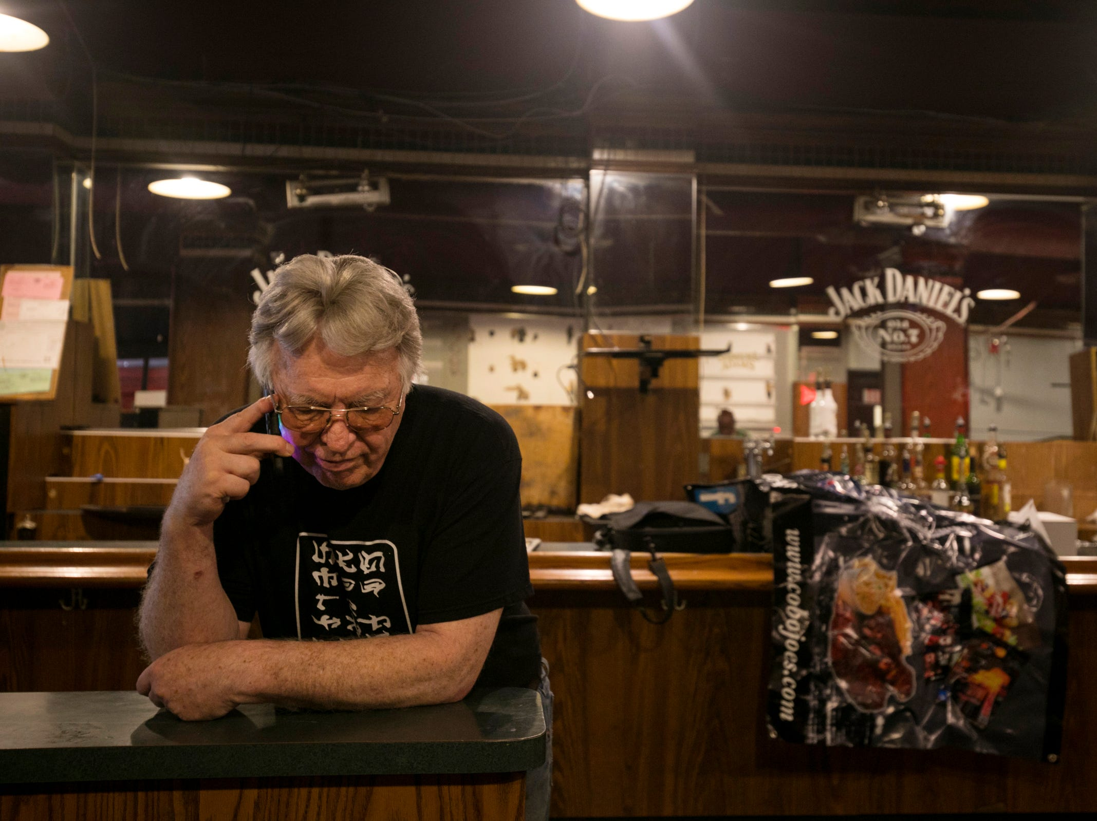 Cobo Joe's co-owner Richard Cadreau, 71, takes a phone call as he packs up memorabilia before closing the doors to the sports bar on Tuesday, July 31, 2018.